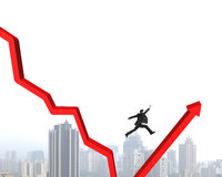 Man jumping red arrow Stock Image