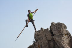 A man jumping from a rock Stock Images
