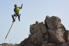A man jumping from a rock Royalty Free Stock Photos
