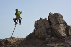 A man jumping from a rock Royalty Free Stock Photo