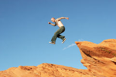 Man jumping on rocks Royalty Free Stock Photography