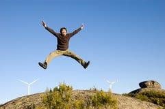 Man jumping on rocks Stock Image
