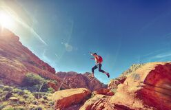 Man jumping on rocks in desert Royalty Free Stock Photo
