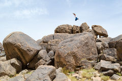 Man jumping on rocks in the desert #1 Royalty Free Stock Photo
