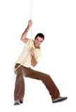 Man jumping on a rope Stock Images