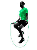 Man jumping rope exercises fitness silhouette. One man exercising jumping rope  fitness  in silhouette isolated on white background Stock Images