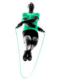 Man jumping rope exercises fitness silhouette Royalty Free Stock Photography