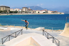 Man jumping with a scateborad on the coast of Ajaccio Royalty Free Stock Images