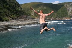 Man Jumping Into Sea Stock Photo