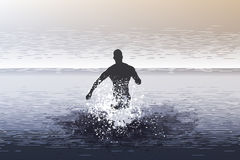 Man jumping into the sea Stock Image