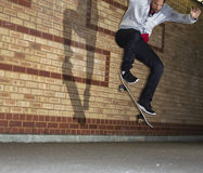 Man jumping on a skateboard Stock Images