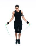 man jumping with skipping rope Stock Photography