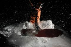 Man jumping with the snowboard in the mountain resort in the nig stock images
