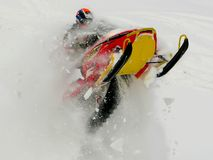 Man jumping snowmobile. Man in winter jumping snowmobile in deep snow Stock Photos