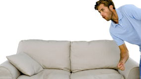 Man jumping on the sofa on white background