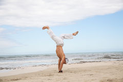 Man is jumping sport karate martial arts fight kick Royalty Free Stock Photography