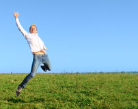 Man jumping on summer field Royalty Free Stock Image