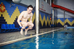 Man jumping in swimming pool. Low angle view from the swimming pool Stock Images
