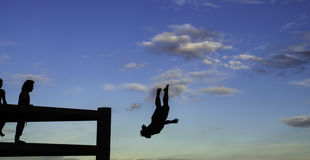 Man jumping to the river. With gang royalty free stock images