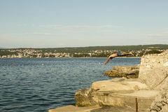 Man jumping in to the sea royalty free stock photo