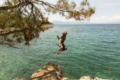 Man jumping in to the sea royalty free stock image