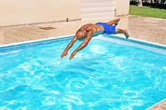 Man jumping to swimming pool.  Stock Photography