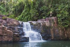 Man jumping to waterfall on Koh Kut island in Thailand Stock Image