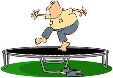Man jumping on a trampoline Royalty Free Stock Images
