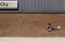 Man Jumping By Wall With 'City' Written On It Royalty Free Stock Photography
