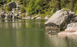 Man jumping into the water. In Laguna negra lake, Soria, Spain Stock Photography