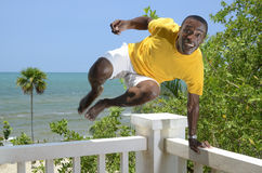 Man jumps from a balcony rail Royalty Free Stock Photos
