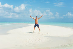 Man jumps on the beautiful beach Royalty Free Stock Images