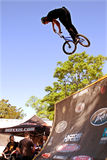 Man Jumps Bike On Ramp Preparing For BMX Competition Royalty Free Stock Photography