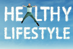 Man jumps with Healthy Lifestyle text royalty free stock photos