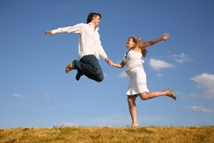 Man Jumps Hold Girl From Hand Stock Photography