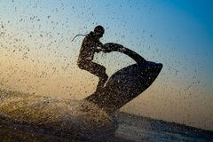 Man jumps on the jetski Royalty Free Stock Photo