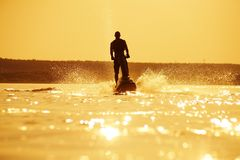 Man jumps on the jetski Stock Images