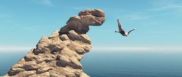 Man jumps into the ocean from a cliff royalty free stock photography
