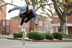 Man Jumps over Skateboard Royalty Free Stock Photography
