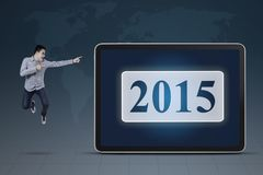 Man jumps and pointing at number 2015 Royalty Free Stock Images