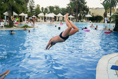 A man jumps into the pool. Tunisia. Summer 2015 Royalty Free Stock Photography