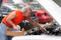 Man Junk Yard Hunting Royalty Free Stock Images