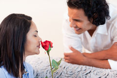 Man just gave his girlfriend a rose Stock Photo