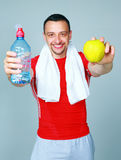 Man just after a workout with water and apple Royalty Free Stock Photo
