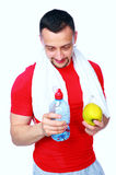 Man just after a workout with water and apple Stock Images