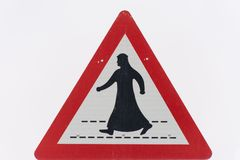 Man in Kandora Crossing the street sign stock images