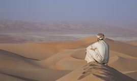 Man in kandura in a desert at sunrise Royalty Free Stock Photography