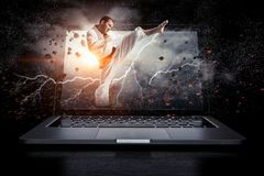 Man in kimono and glowing laptop. Mixed media Royalty Free Stock Images