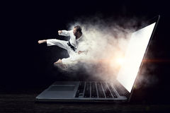 Man in kimono and glowing laptop. Mixed media Royalty Free Stock Image