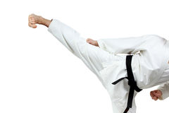 Man in karategi beats blow leg Royalty Free Stock Image